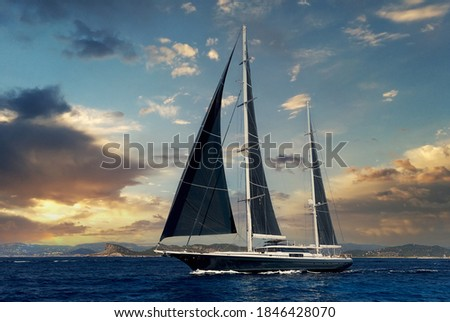 Two-masted yacht in the Mediterranean sea during bright majestic sunset. Ibiza, Balearic Islands. Europe, Spain Royalty-Free Stock Photo #1846428070
