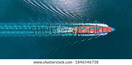 Aerial top view of cargo maritime ship with contrail in the ocean ship carrying container and running for export  concept technology freight shipping by ship smart service Royalty-Free Stock Photo #1846546738