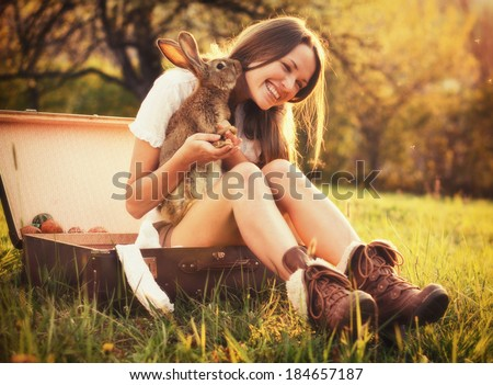 Friendship with an Easter Bunny / Vintage style photo from a beautiful young woman with her bunny
