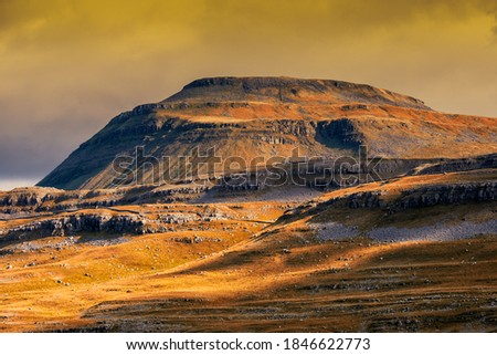 Ingleborough is the second-highest mountain in the Yorkshire Dales, England. It is one of the Yorkshire Three Peaks, and is frequently climbed as part of the Three Peaks walk. Royalty-Free Stock Photo #1846622773