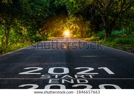 New year 2021 or start straight concept.word 2021 written on the road in the middle of asphalt road at sunset.Concept of planning and challenge or career path,business strategy,opportunity and change #1846657663