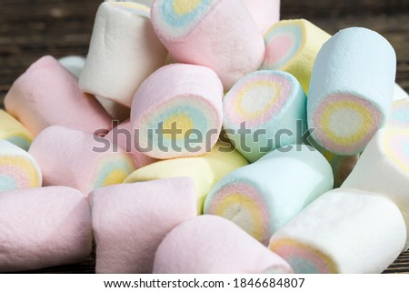 colored sweet soft cylindrical marshmallows made from sugar, gelatin, starch and other ingredients, closeup sweet marshmallows Royalty-Free Stock Photo #1846684807