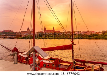 Wooden sail ship anchored on a pier with view at Chrobry Shafts at the Days of the Sea festival in Szczecin. Beautiful sunset over cityscape Royalty-Free Stock Photo #1846779043