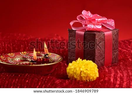 Diwali gift Box & Diwali Lamps, Beautiful clay diya lamps lit during diwali celebration