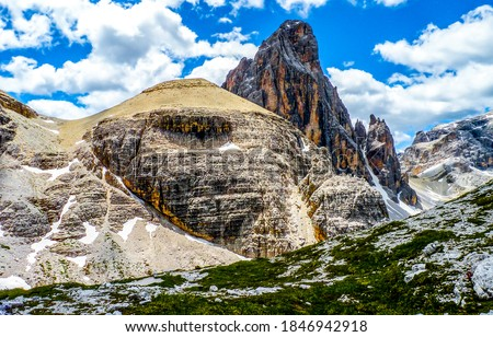 Mountain rocks on blue sky clouds background. Mountain peak snow in mountains. Mountain rock view #1846942918