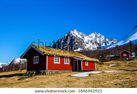 Mountain cabin at snowy peak. Red wooden cabin in mountains. Mountain cabin view. Cabins in mountains #1846942921