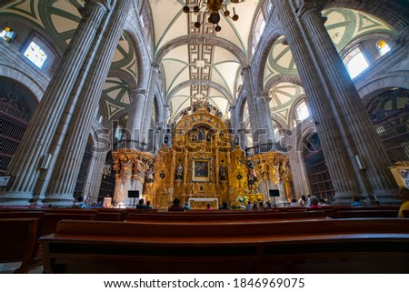 Panoramic of the interior of the Metropolitan Cathedral of Mexico City with many people entering and leaving admiring the beautiful architecture Royalty-Free Stock Photo #1846969075