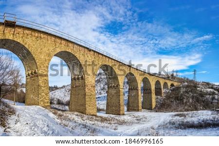 Plebanivka, Ukraine 01.06.2020. Viaduct in Plebanivka village, Terebovlyanskiy district of Ukraine, on a sunny winter day Royalty-Free Stock Photo #1846996165