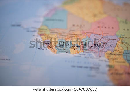 Close up picture focused on Ivory Coast on a colorful map of West Africa with its main routes marked in red and with the rest of the countries blurred out