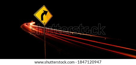 Turn Right traffic sign with light trail background