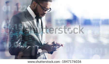 Modern Trader. Collage of forex trading graph chart layered over black businessman using smartphone outdoors, creative financial background with stock market data, panorama with copy space Royalty-Free Stock Photo #1847176036