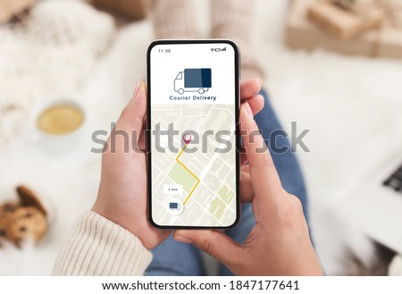 Modern courier delivery at home, shopogolic and online shopping. Hands of lady holding smartphone with mobile app and map to track the order on digital screen on blurred background, collage, cropped Royalty-Free Stock Photo #1847177641