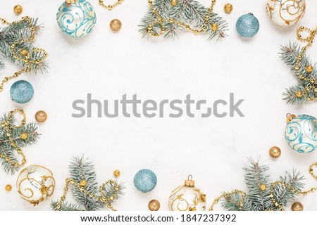 Christmas frame on white holiday background. Gold and blue christmas decorations, Copy space. New Year border.