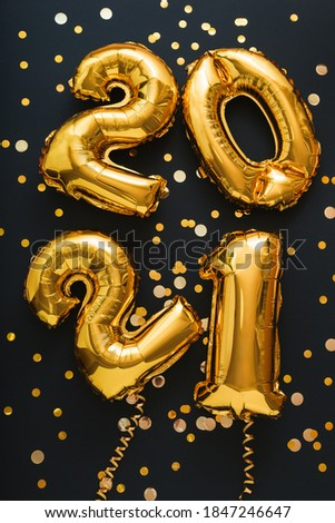 2021 balloon gold text on black background with golden confetti, festive decor. Happy New year eve invitation with Christmas gold foil balloons 2021. Vertical #1847246647
