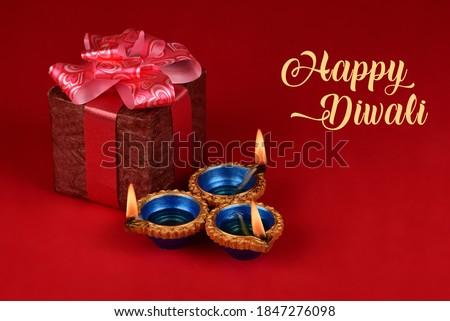 Happy Diwali - Beautiful clay diya lamps lit during diwali celebration, Diwali gift & Diyas