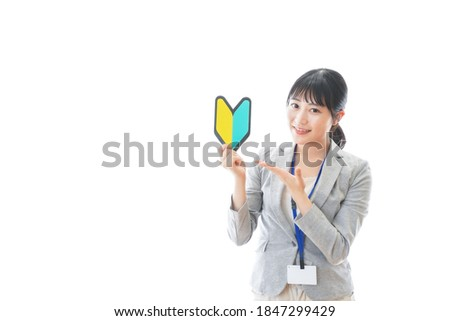 Young business person with a beginner mark
