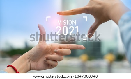 New year 2021 or start straight concept.Business woman making frame round and word vision 2021 with her hands.Concept of planning and challenge or career path,business strategy,opportunity and change Royalty-Free Stock Photo #1847308948