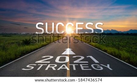 New year 2021 or start straight concept.word 2021 and strategy written on the road of asphalt road at sunset.Concept of target and challenge or career path,success business,opportunity and change #1847436574