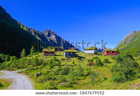 Mountain green valley cabins landscape. Mountain cabins view. Mountain cabins landscape. Mountain cabins #1847679592