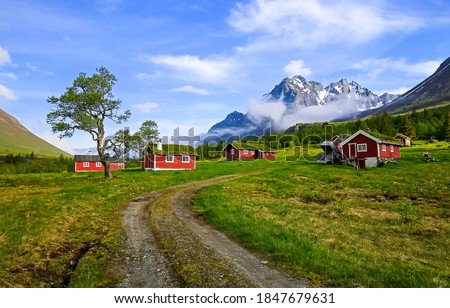 Road to mountain cabins landscape. Mountain cabins view. Mountain red cabins landscape. Mountain cabins #1847679631