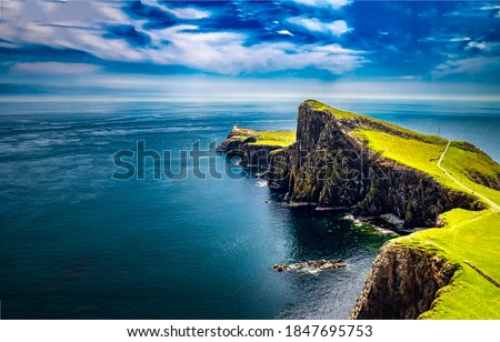 Lighthouse at edge of sea cliff. Sea  coastal cliff landscape. Coastal cliss view Royalty-Free Stock Photo #1847695753