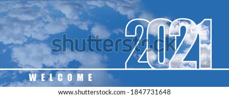 Welcome to the New year 2021. Large numbers with a white cloud texture on the sky background. New year's holiday concept, copyspace, banner. Royalty-Free Stock Photo #1847731648