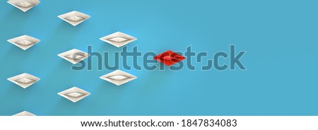 paper boat leadership concept - red paper boat leading the row.3d rendering