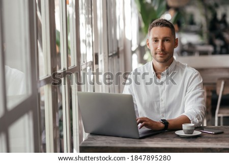 young man working on his computer at the cafe. business, freelance Royalty-Free Stock Photo #1847895280