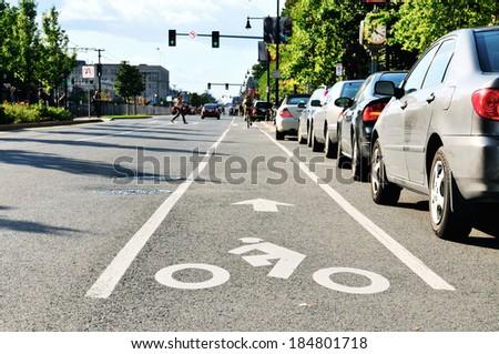 Bike lane in city street Royalty-Free Stock Photo #184801718