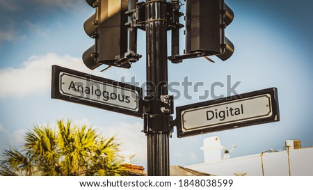 Street Sign the Direction Way to Digital versus Analogous Royalty-Free Stock Photo #1848038599