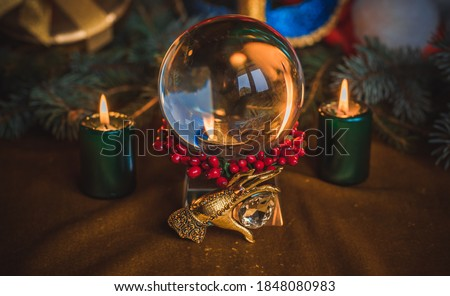 Concept of Christmas divination predictions on tarot cards, magical ball and other magic Royalty-Free Stock Photo #1848080983