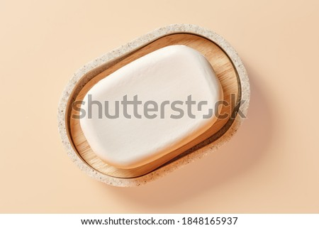 Soap in a soap dish close up. Top view isolated on beige, clipping path included Royalty-Free Stock Photo #1848165937