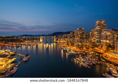 False Creek and Downtown Vancouver buildings at dusk in Vancouver, British Columbia, Canada.