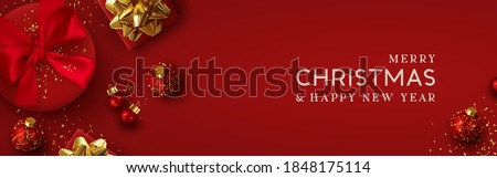 Christmas banner. Background Xmas design of realistic red gift box, 3d render bauble ball and glitter gold confetti. Horizontal christmas poster, greeting card, headers for website. Happy New Year.
