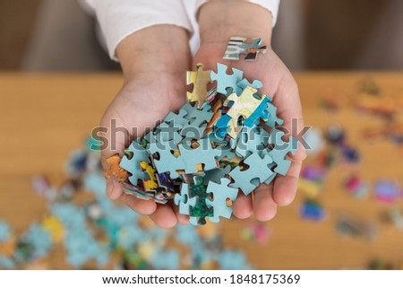 Home puzzle game. rest from gadgets and peace of mind. Royalty-Free Stock Photo #1848175369