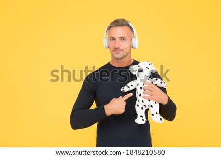 Its more then a toy. Handsome man point finger at toy dog. Toyshop. Play and game. Imaginative activity. Learning fun together. Royalty-Free Stock Photo #1848210580