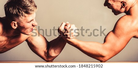 Rivalry, vs, challenge, strength comparison. Two men arm wrestling. Arms wrestling, competition. Rivalry concept - close up of male arm wrestling. Leadership concept.