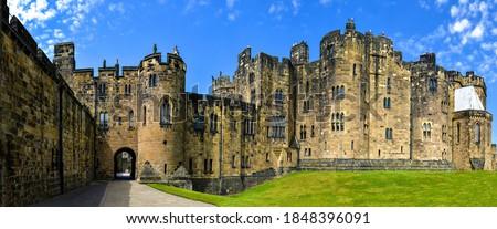 Medieval stone castle panoramic landscape. Castle in England. Medieval castle panorama. Castle landmark #1848396091