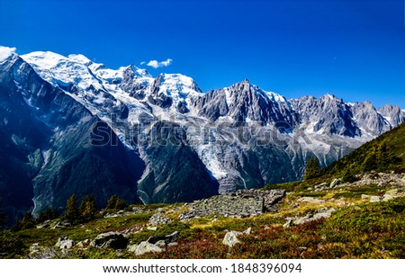 Mountain peaks snow landscape view. Snowy mountain peaks. Snowy mountain peaks landscape. Mountain view #1848396094