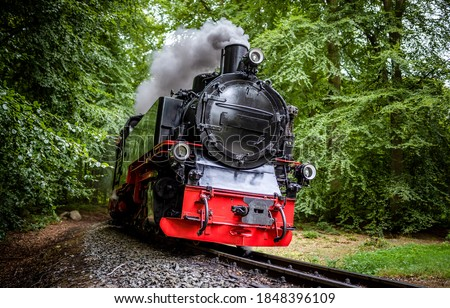 Steam train on railroad ride. Locomotive. Steam train Royalty-Free Stock Photo #1848396109