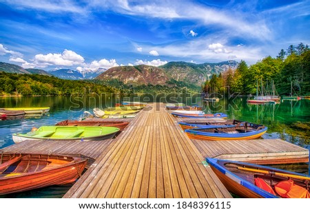 Boat dock on the lake. Lake pier boats. Boats on lake dock. Boats on lake pier Royalty-Free Stock Photo #1848396115