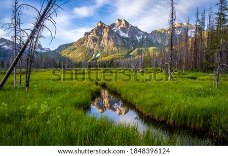 Mountain valley creek landscape view. Cold creek in mountain valley. Mountain peak landscape. Mountain valley water #1848396124