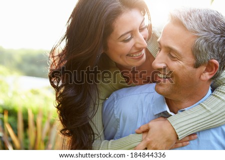 Loving Hispanic Couple In Countryside Royalty-Free Stock Photo #184844336