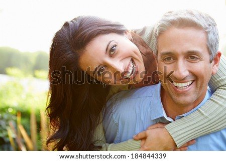 Portrait Of Loving Hispanic Couple In Countryside #184844339