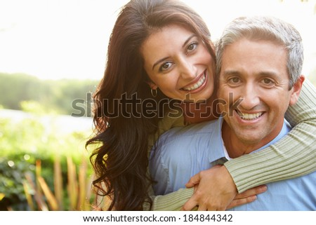 Portrait Of Loving Hispanic Couple In Countryside #184844342