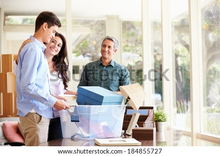 Parents Helping Teenage Son Pack For College #184855727