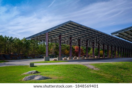 Abstract Geometry of Solar Panels Covering the Parking Lot and Green Garden with Zen-like Rocks