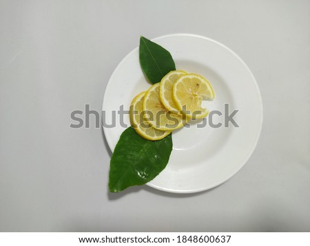 lemon on plate sliced ​​and garnished #1848600637
