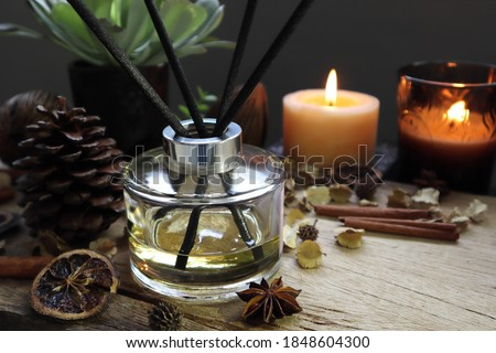 luxury aromatic scented reed diffuser or air freshener decorated on wooden table in the living room of the house during Christmas new year party celebration  #1848604300