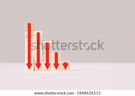 Ladder made of wooden blocks with red arrows down, side view. Decline, decrease, down, drop. Business statistic. Career, money, success concept. Regression, crisis.
